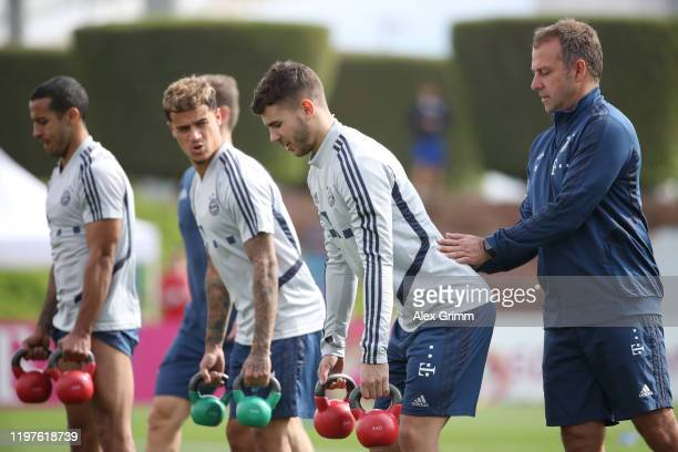 Head coach Hansi Flick helps Lucas Hernandez during a training session at Aspire Zone during day two of the FC Bayern Muenchen winter training camp...