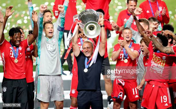 Head coach Hansi Flick of Bayern Muenchen celebrates the victory with the trophy during the UEFA Champions League Final match between Paris...