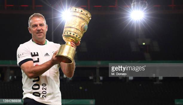 Head coach Hansi Flick of Bayern Muenchen celebrates with the trophy during the DFB Cup final match between Bayer 04 Leverkusen and FC Bayern...