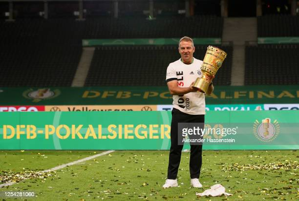 Head coach Hansi Flick of FC Bayern Muenchen poses with the trophy in celebration after the DFB Cup final match between Bayer 04 Leverkusen and FC...