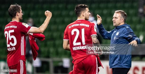 Head coach Hansi Flick of München celebrates with Thomas Müller after winning the Bundesliga match between SV Werder Bremen and FC Bayern München at...