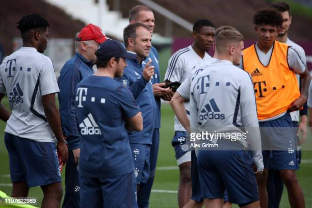 Head coach Hansi Flick talks to players during a training session at Aspire Zone during day two of the FC Bayern Muenchen winter training camp on...