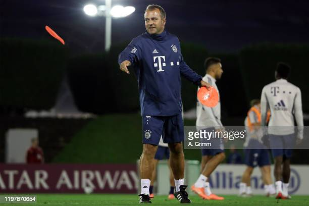 Head coach Hansi Flick throws a pitch marker during a training session on day three of the FC Bayern Muenchen winter training camp at Aspire Academy...
