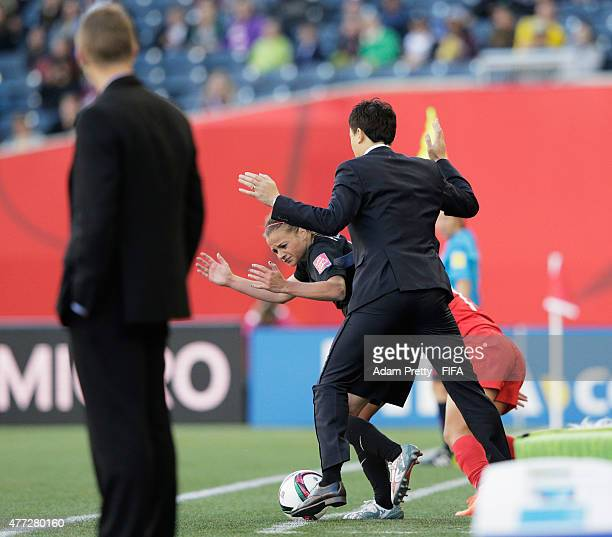 Head Coach Hao Wei of China interferes with Ria Percival of New Zealand and is sent off during the FIFA Women's World Cup 2015 Group A match between...