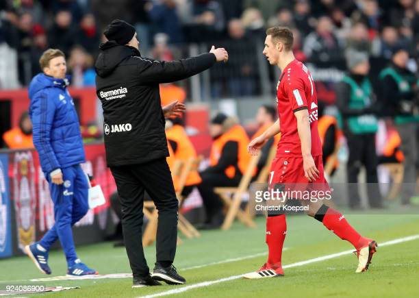 Head coach Heiko Herrlich cares of Dominik Kohr of Leverkusen after being sent off the pitch getting a yellow red card during the Bundesliga match...