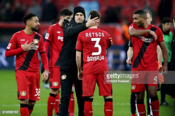 Head coach Heiko Herrlich comforts Panagiotis Retsosm of Leverkusen after the Bundesliga match between Bayer 04 Leverkusen and Hertha BSC at BayArena...