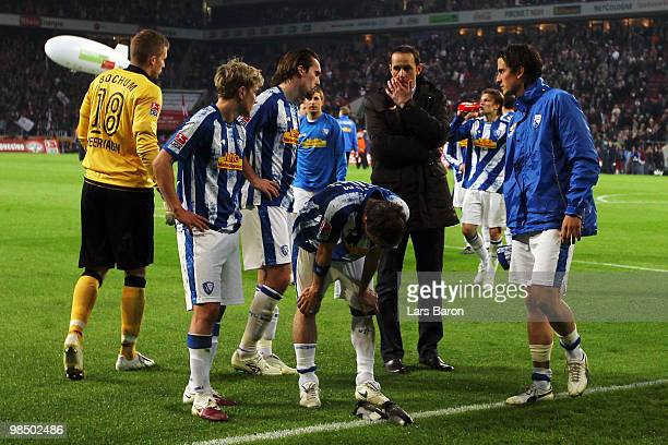 Head coach Heiko Herrlich of Bochum and his players are looking dejected after loosing the Bundesliga match between 1 FC Koeln and VfL Bochum at...
