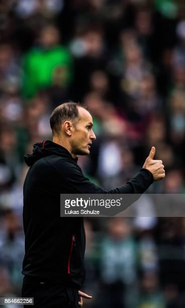 Head Coach Heiko Herrlich of Leverkusen gestures on the sideline during the Bundesliga match between Borussia Moenchengladbach and Bayer 04...