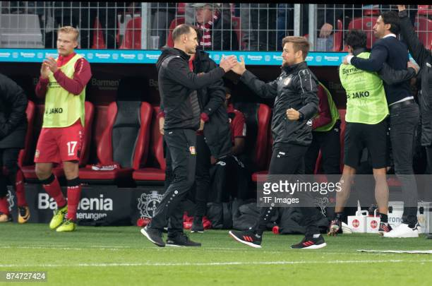 Head coach Heiko Herrlich of Leverkusen shakes his hand with cocoach Nico Schneck during the Bundesliga match between Bayer 04 Leverkusen and 1 FC...