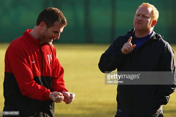 Head coach Heiko Vogel talks to Alexander Frei during a training session of FC Basel ahead of their UEFA Champions League Round of 16 first leg match...