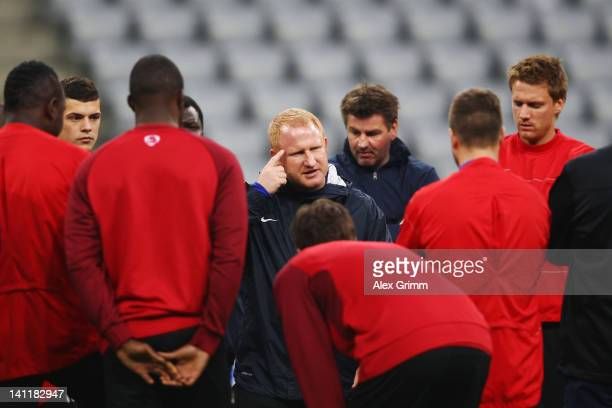 Head coach Heiko Vogel talks to players during a FC Basel training session ahead of their UEFA Champions League Round of 16 second leg match against...