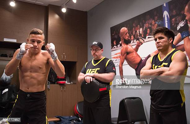 Head coach Henry Cejudo watches as Kai KaraFrance warms up before facing Terrence Mitchell during the filming of The Ultimate Fighter Team Benavidez...