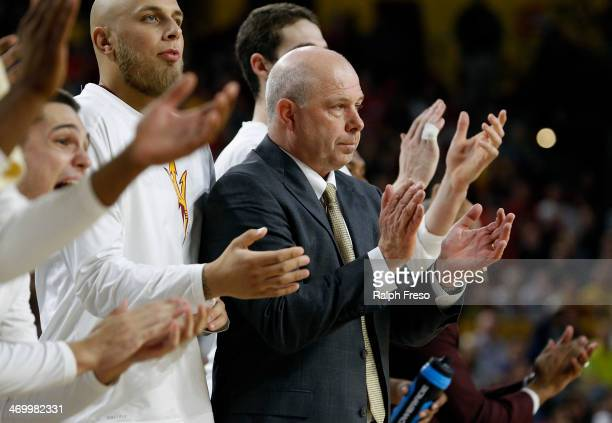 Head coach Herb Sendek of the Arizona State Sun Devils applauds after a basket during the second half of a college basketball game against the...