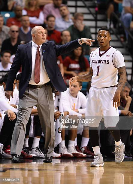 Head coach Herb Sendek of the Arizona State Sun Devils gestures to his players as Jahii Carson walks by during a quarterfinal game of the Pac12...
