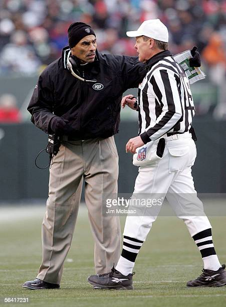 Head coach Herman Edwards of the New York Jets discusses a call with referee Scott Green during the game against the Oakland Raiders on December 11...