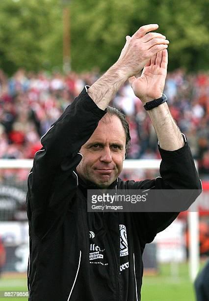 Head coach Hermann Andreev of Plauen celebrates after the Regionalliga match between Hallescher FC and VFC PLauen at the Kurt Wabbel Stadium on June...