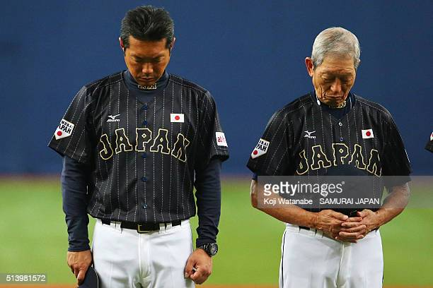 Head coach Hiroki Kokubo and coach Hiroshi Gondo of Japan observe a minute of silence for the victims of the Great East Japan Earthquake firve years...