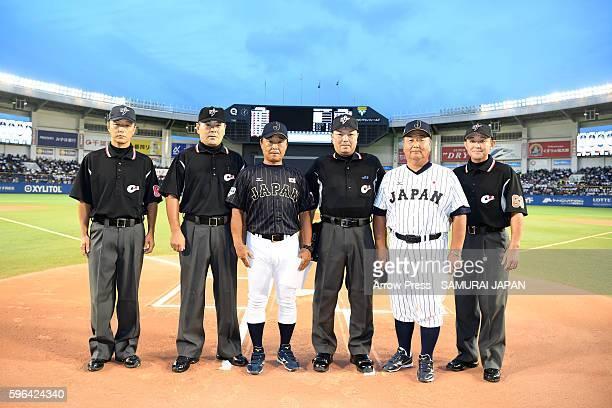 Head Coach Hiroki Yokoi of Collegiate Japan and Second from the rightjHead Coach Mamoru Koeda of U18 Japan pose for a photo in the sendoff game...