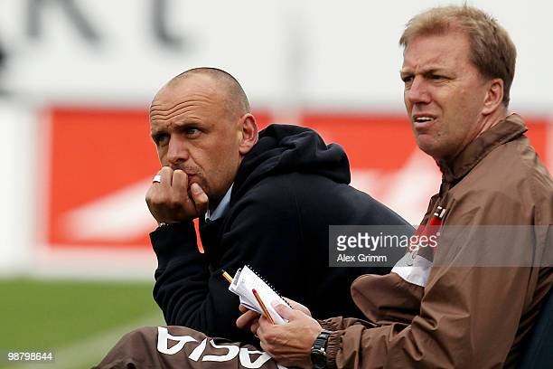 Head coach Holger Stanislawski of St. Pauli and assistant coach Andre Trulsen react during the Second Bundesliga match between SpVgg Greuther Fuerth...