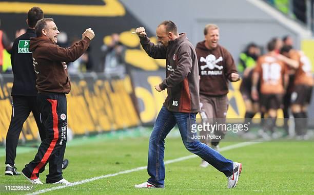 Head coach Holger Stanislawski of St. Pauli celebrates after Matthias Lehman of St. Pauli scored his team's second goal the Bundesliga match between...
