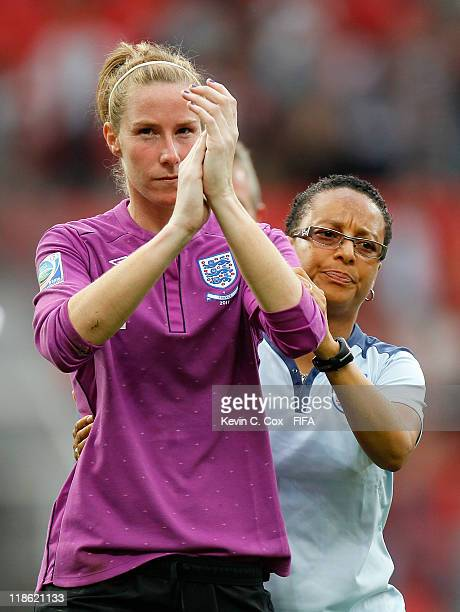 Head coach Hope Powell of England hugs goalkeeper Karen Bardsley after their 54 penalty shootout loss to France during the FIFA Women's World Cup...