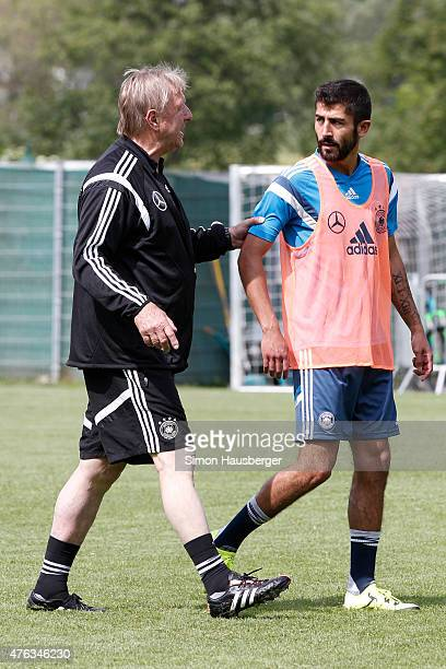 Head Coach Horst Hrubesch and Kerem Demirbay of the U21 German National team Talking during a training session on June 8 2015 in Leogang Austria