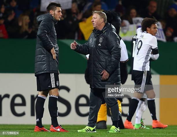 Head coach Horst Hrubesch of Germany talks to Niklas Suele after the 2017 UEFA European U21 Championships qualifier match between Germany U21 and...