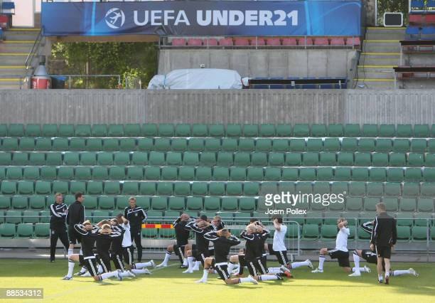 Head coach Horst Hrubesch of Germany watches his players during the U21 German National Team training session at the Oerjans vall stadium on June 17...