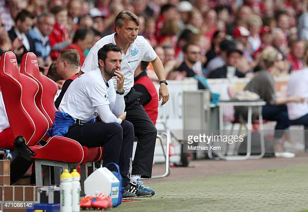 Head coach Horst Steffen of Stuttgart and assistant coach Sreto Ristic look on during the third league match between FC Energie Cottbus and SV...