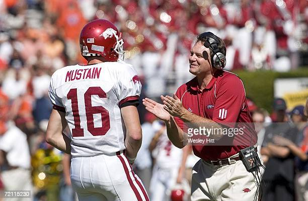 Head Coach Houston Nutt of the Arkansas Razorbacks talks with his freshman quarterback Mitch Mustain during a game against the Auburn Tigers at...