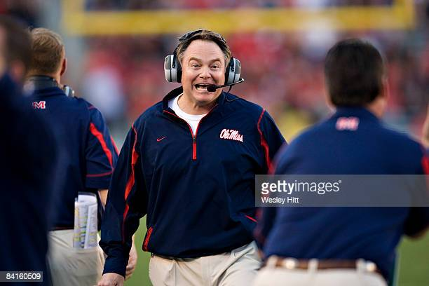 Head Coach Houston Nutt of the Ole Miss Rebels celebrates near the end of the game against the Texas Tech Red Raiders during the ATTCotton Bowl on...