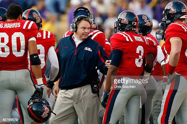 Head coach Houston Nutt of the Ole Miss Rebels talks with his team during a timeout against the Louisiana State University Tigers on November 22,...