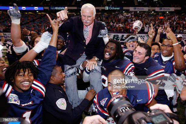 Head coach Howard Schnellenberger of the Florida Atlantic University Owls is carried on his team's shoulders after defeating the Memphis University...