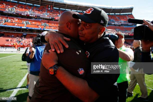Head coach Hue Jackson of the Cleveland Browns and head coach Marvin Lewis of the Cincinnati Bengals hug after the game at FirstEnergy Stadium on...