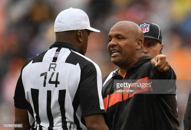 Head coach Hue Jackson of the Cleveland Browns argues a call with referee Shawn Smith during the second quarter against the Pittsburgh Steelers at...