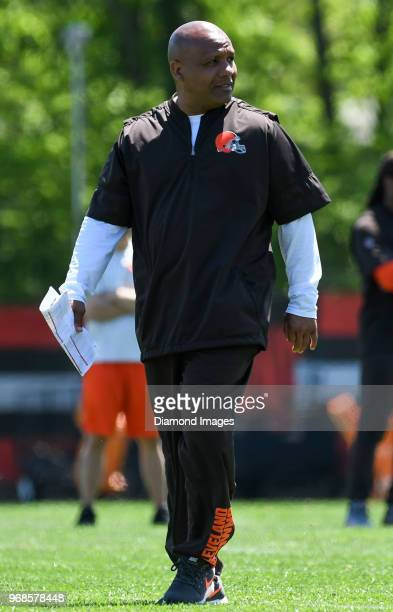 Head coach Hue Jackson of the Cleveland Browns walks onto the field during an OTA practice at the Cleveland Browns training facility in Berea Ohio