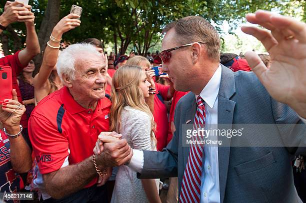 Head coach Hugh Freeze of the Mississippi Rebels greets fans during the Walk of Champions prior to their game against the Memphis Tigers on September...