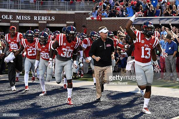Head coach Hugh Freeze of the Mississippi Rebels leads his team onto the field prior to a game against the Texas AM Aggies at VaughtHemingway Stadium...