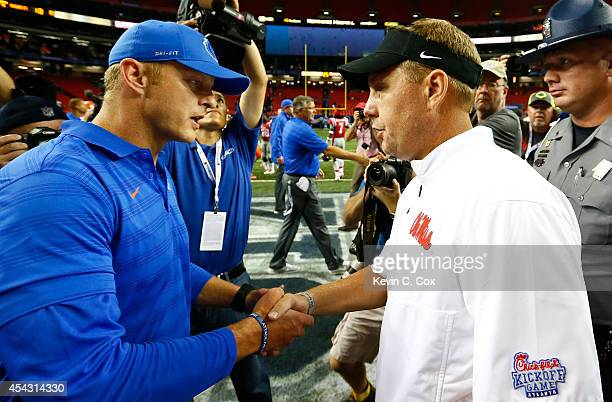 Head coach Hugh Freeze of the Mississippi Rebels shakes hands with head coach Bryan Harsin of the Boise State Broncos after their 3513 win at Georgia...