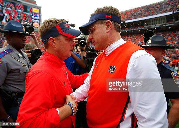 Head coach Hugh Freeze of the Mississippi Rebels shakes hands with head coach Gus Malzahn of the Auburn Tigers after their 2719 win at JordanHare...