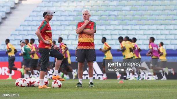 Head coach Hugo Broos and assistant coach Sven Vandenbroeck look on during a Cameroon training session at Fisht Olympic Stadium ahead of their FIFA...