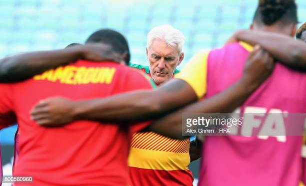 Head coach Hugo Broos stands together with the players during a Cameroon training session at Fisht Olympic Stadium ahead of their FIFA Confederations...