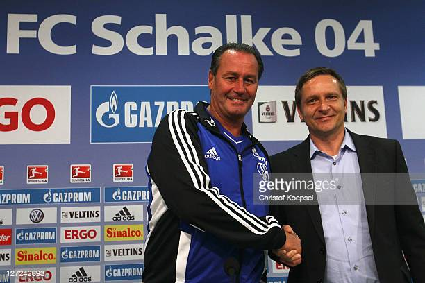 Head coach Huub Stevens and Horst Heldt shake hands during the FC Schalke press conference at the Veltins Arena on September 27 2011 in Gelsenkirchen...