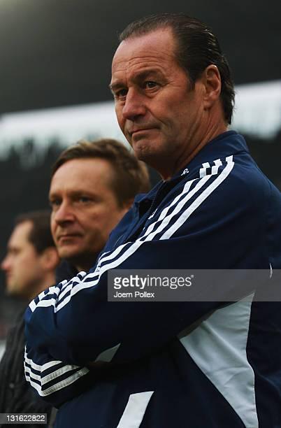 Head coach Huub Stevens and manager of Schalke, Horst Heldt of Schalke look on prior to the Bundesliga match between Hannover 96 and FC Schalke 04 at...
