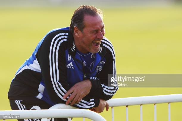 Head coach Huub Stevens laughs during a training session of Schalke 04 at the ASPIRE Academy for Sports Excellence on January 6 2012 in Doha Qatar