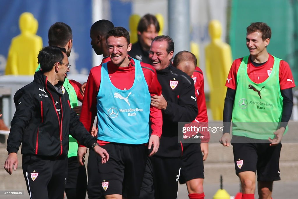 Head coach Huub Stevens laughs with Christian Gentner during a VfB Stuttgart training session at the club's training ground on March 11, 2014 in Stuttgart, Germany.
