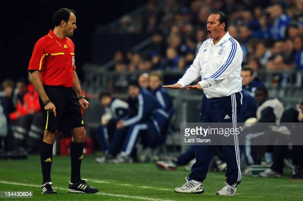 Head coach Huub Stevens of Schalke discusses with referee Antonio Miguel Mateu Lahoz during the UEFA Europa League group J match between FC Schalke...