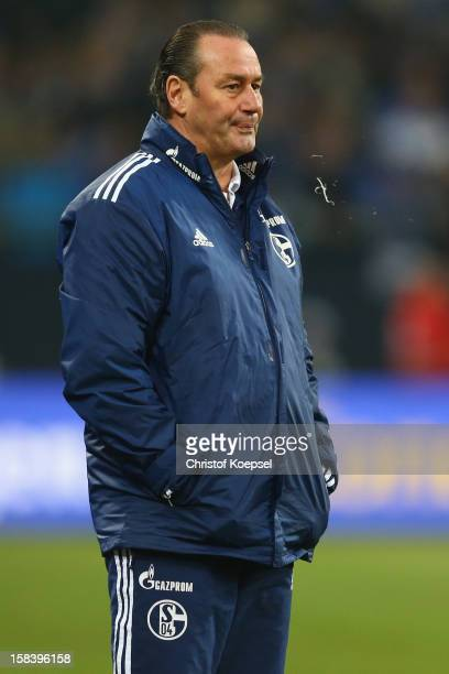 Head coach Huub Stevens of Schalke spitts during the Bundesliga match between FC Schalke 04 and SC Freiburg at VeltinsArena on December 15 2012 in...