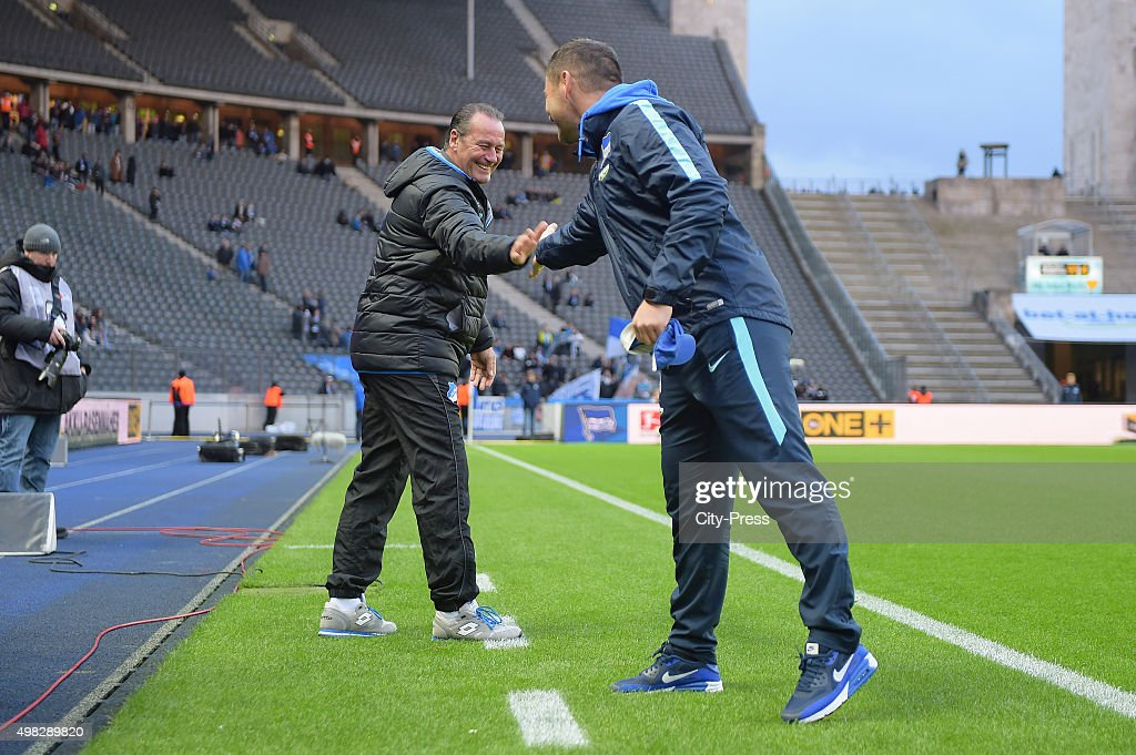 Head coach Huub Stevens of TSG 1899 Hoffenheim and coach Pal Dardai of Hertha BSC chat prior the Bundesliga match between Hertha BSC and TSG Hoffenheim on November 22, 2015 in Berlin, Germany.