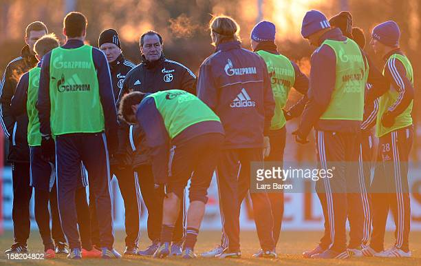 Head coach Huub Stevens speaks to his players during a FC Schalke 04 training session on December 11 2012 in Gelsenkirchen Germany